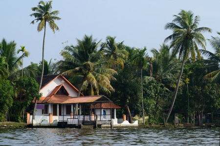 alappuzha: Rural church at Alappuzha backwaters,South India.Kerala backwaters is a chain of lagoons and lakes lying parallel to Malabar Coast, famous tourist attraction and unesco heritage site