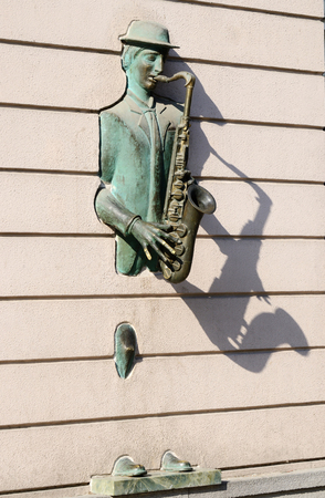 rustaveli: Tbilisi, Georgia,September 16, 2014 -  Bronze statue of saxophonist coming through the wall on Rustaveli street in old Tbilisi, Georgia.