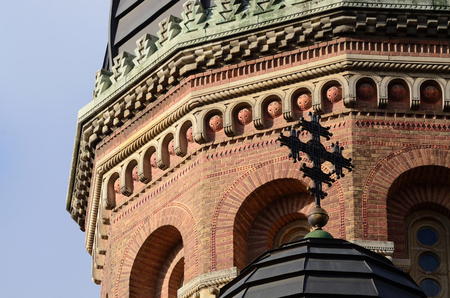 chernivtsi: Closeup of brick orthodox Seminary church dome with cross on its top in former archiepiscopal residence complex Chernivtsi University, Ukraine,unesco heritage