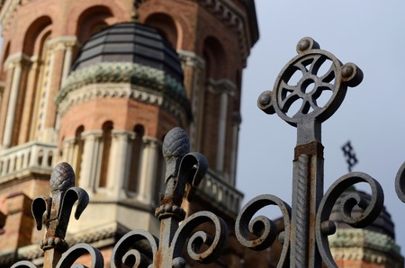 chernivtsi: Closeup of beautiful fence in former archiepiscopal residence complex Chernivtsi University - cross and pinecone, Western Ukraine,unesco world heritage site