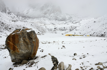 reference point: Big stone - final path sign on South Everest Base Camp trek,Himalayas,Nepal,Asia.It is used when climbing via the southeast ridge Stock Photo