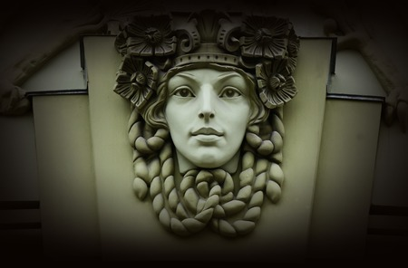 heads old building facade: Beautiful woman head,old architectural decoration,art nouveau style Stock Photo