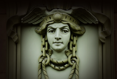 old mercury: Beautiful head of Mercury (Hermes) ,ancient god of commerce in greek and roman mythology ,old architectural decoration,art nouveau style