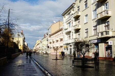 chernivtsi: CHERNIVTSI, UKRAINE - DECEMBER 1, 2015: view of Olga Kobylyanska avenue after rain - the only one pedestrian street in town on December 1 in Chernivtsi,Ukraine.It is historical center of Chernivtsi and popular walking route.Chernovtsy is a city in western