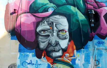 PAPHOS, CYPRUS - APRIL 19, 2016: Closeup of street graffiti art murals depicting fairy-tale human face in old center of Paphos,Cyprus,Europe