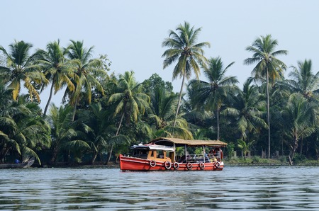 alappuzha: Tourist boat at Kerala backwaters,Alleppey,India.Its a chain of lagoons and lakes near Arabian Sea  (Malabar Coast) of Kerala state in southern India