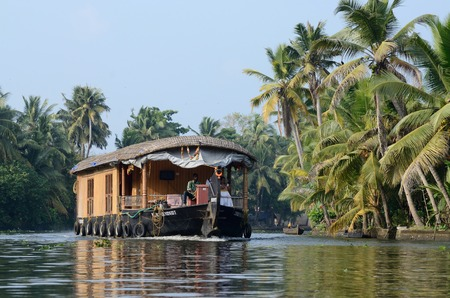 alappuzha: ALLEPPEY, INDIA - DECEMBER 10: unidentified tourist boat at Kerala backwaters on December 10, 2013 in Alleppey,Kerala,India.Its a chain of lagoons and lakes lying parallel to Malabar Coast Editorial