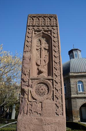 Stone cross in Echmiadzin (Vagharshapat) made of red stone tufa