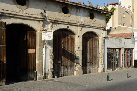 eponymous: LARNACA, CYPRUS - APRIL 7, 2016: closed old storehouses came from english colonial times,now it is souvenir shops, cafes,art galleries and restaurant.Larnaca - city on southern coast of Cyprus and capital of the eponymous district