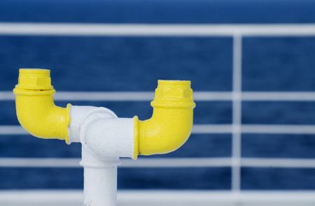 nautical equipment: Nautical equipment of the ferry boat deck - yellow pipe and white railing on the background