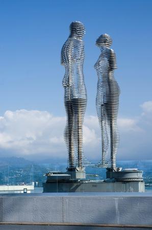azerbaijani: BATUMI, GEORGIA - OCTOBER 7: Futuristic moving metal sculpture Love of Ali and Nino on October 7, 2016 in Batumi, Georgia.Statues described story of muslim Azerbaijani boy and Christian Georgian girl Editorial