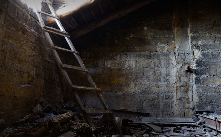 attic: Roof space of abandoned house with old floor covered with guano, Odessa, Ukraine ,Europe