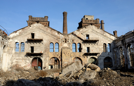 Ruins of old abandoned plant with gas furnace chimney,Odessa,Ukraine