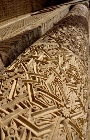 Traditional geometrical muslim ornaments on the column of 12th century Karakhanid mausoleum in Uzgen,Osh Region, Kyrgyzstan,unesco heritage site