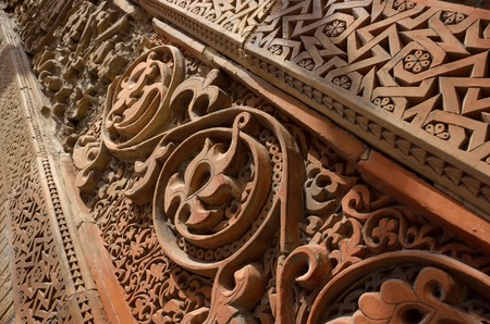 Traditional geometrical and floral muslim ornamental patterns on the medieval Karakhanid s tomb in Uzgen,Osh Region, Kyrgyzstan,