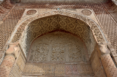 Mausoleum or gumbez,ancient tomb of Karakhanid 's dynasty covered with beautiful geometrical and floral muslim ornaments,llocated in Uzgen,Kyrgyzstan's silk road oldest towns,
