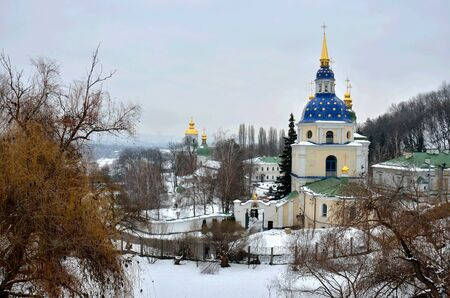 Vydubychi Monastery complex in wintertime, Kyiv, Ukraine,view from Hryshko National Botanical Garden.It was established between 1070 and 1077 by Vsevolod, son of Yaroslav the Wise and became a family cloister of Vsevolod's son Vladimir Monomakh