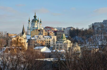 Kyiv skyline and Saint Andrew's Church located at the top of Andriyivskyy Descent in Kiev ,view from Horovitsya (Lysaya gora) mountain,famous as place of power, where witches held Sabbath Фото со стока