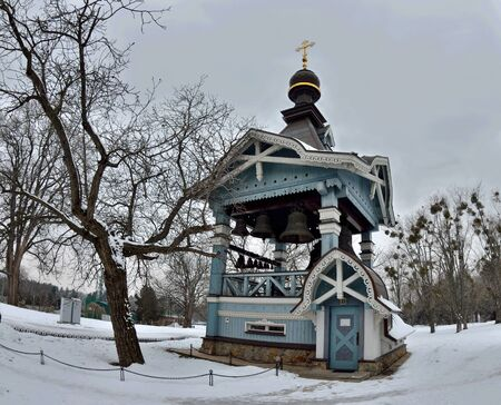 Wooden Belfry of Holy Trinity monastery of Saint Jonah with beautiful carving, located in botanical garden of Hryshko,Kiev Ukraine