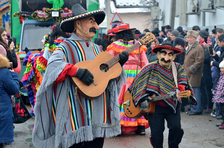 Vashkivtsi,Bukovina,Ukraine - January 14, 2019: Men dressed as mexican musicians in ponchos and sombreros playing guitars at traditional Pereberia (means change clothes) carnival.Its a festival held on Old New Years Day and Malanka Editorial
