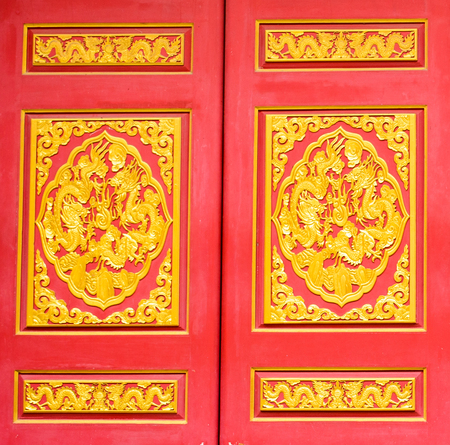 decorration: Dragon door art of Chinese is in Chinese temple Nonthaburi Thailand