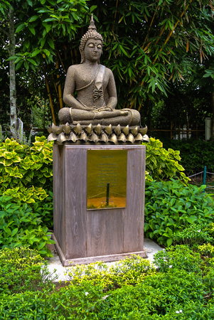 decorration: Buddha made from scrap iron is in the garden Chiang Rai northern Thailand Stock Photo