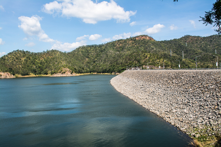 The Srinagarind Dam is an embankment dam in Kanchanaburi Province, Thailand. The main purpose of the dam is river regulation and hydroelectric power generation.