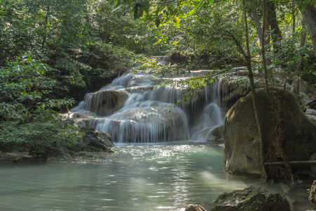 Erawan waterfalls are big and beautiful in Kanchanaburi Province Thailand has a large garden with beautiful trees.