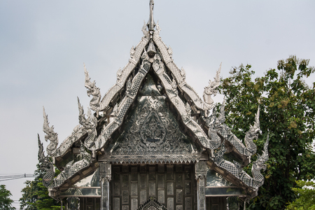 adentro y afuera: Buddhist temple decorated from stainless steel both outside and inside Wat Pho Rattanaram in Ratchaburi Thailand.