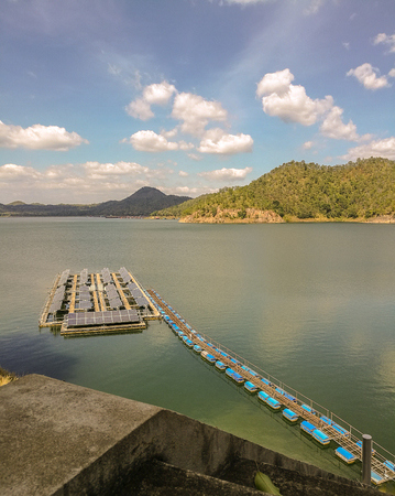 The Srinagarind Dam is an embankment dam in Kanchanaburi Province, Thailand. The main purpose  is river regulation and hydroelectric power generation. Stock Photo