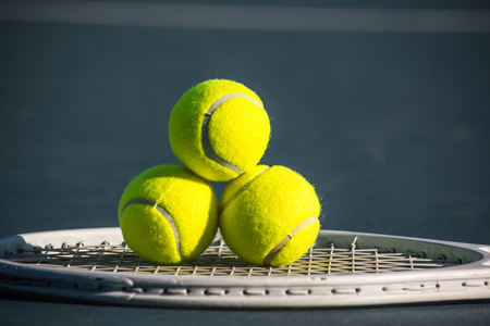 Tennis is a  sport and is played at all levels of society and at all ages. The sport can be played by anyone who can hold a racket. The modern game of tennis originated in Birmingham, England Stock Photo