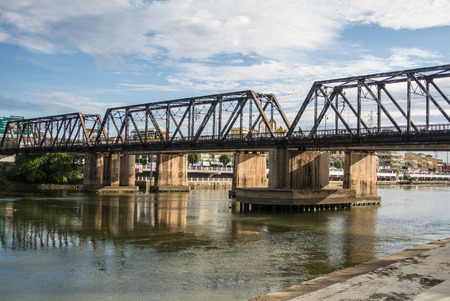 Beautiful clouds in the sky at Mae Klong river and railway bridge Ratchaburi province Thailand