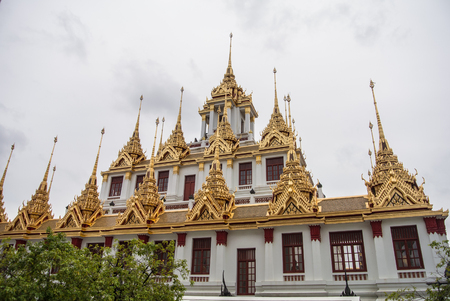 contain: Loha Prasat Wat Ratchanatdaram in Bangkok Thailand which means iron castle or monastery is composes of five towers, of which the outer, middle and the center tower contain large black iron spires.