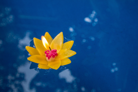 Candle Krathong floats in the water to make merit in a temple Thailand Stock Photo
