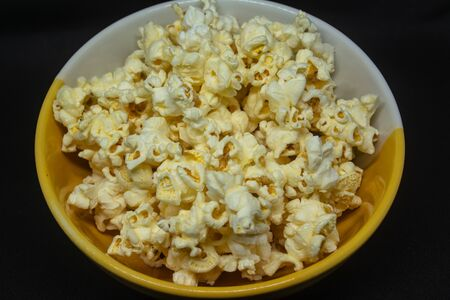 Popcorn is a snack made from corn kernels it is white color popular for people in many countries.