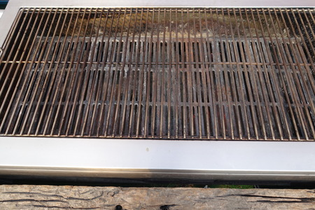 metal grate: High angle diagonal view of a barbecue grill grate