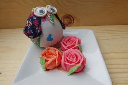 palatable: Thai rose Aalaw dessert on wooden background