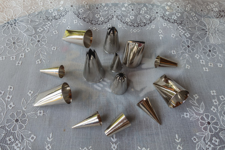 metal tips: Various metal icing tips for decorating cakes and cookies with frosting