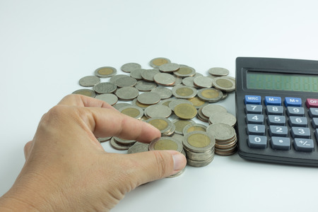 counting money: hand counting money on calculato