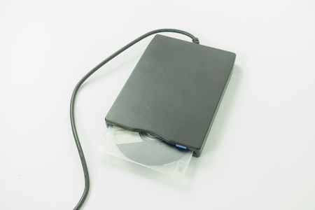 dataset: black external usb floppy disk drive with a white disk inside,on white background