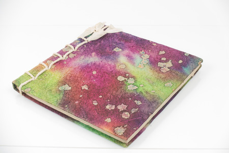 handmade notebook made from mulberry paper with isolated on white background.