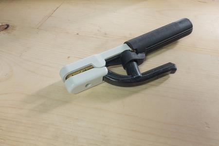 electrode: Welding electrode holder on wooden background
