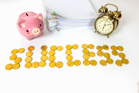 Sort the gold coins medal success with piggy bank, pile paperwork and clock on white background Stock Photo
