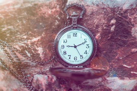 12 o clock: Time Concept vintage pocket watch on rock