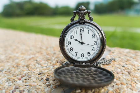 Time Concept vintage pocket watch on blur natural background Stock Photo