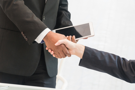 Hands of businessmen handshake agreement.