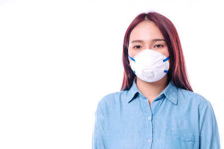 Young women wear face masks to protect disease viruses covid19 and air pollution (PM2.5) or N95 mask safe her healthy problem on isolated white background. Фото со стока