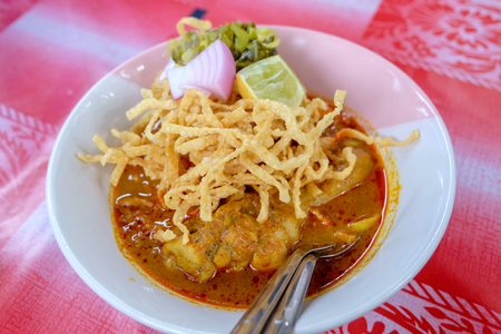 Northern Thai Cuisine  with spicy curry soup  topping with Lemon, Pickled, Lettuce or Khao Soi Recipe, Northern Style Curried Noodle Soup with Chicken
