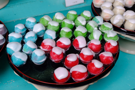 Blue - Red - Green apple dessert or Thai Dessert in black dish 免版税图像