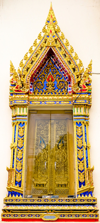 Wooden ancient Thai Style Door of ordination hall at Wat Poramaiyikawas Worawihan, Koh Kret, Nonthaburi